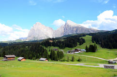 Dolomites mountains landscape. Scenic landscape of the Dolomites mountains with village in foreground and Sassopiatto and Sassolungo or Langkofel peaks stock photography
