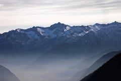 Dolomites Mountains in Winter. Italian Dolomites Mountains in fog and winter mist Royalty Free Stock Image