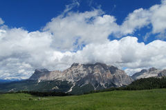 Dolomites range above green hill Stock Images