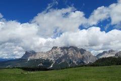 Dolomites range above green hill Stock Images