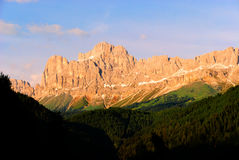 Dolomites Rosengarten Latemar. Mountain alps with the warm colors of sunset Stock Photos
