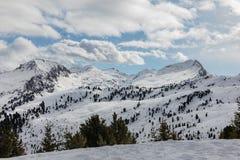Dolomites, ski area with beautiful slopes. Empty ski slope in winter on a sunny day. Prepare ski slope, Alpe Cermis, Italy Stock Photos