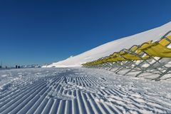 Dolomites, ski area with beautiful slopes. Empty ski slope in winter on a sunny day. Prepared piste and sunny day Royalty Free Stock Images