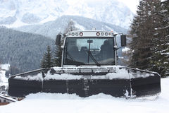 Dolomites skiing resort. Snowcat. Snow remover equipment. Royalty Free Stock Photos