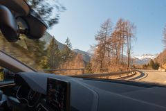 Dolomites in spring and road from the car royalty free stock photography