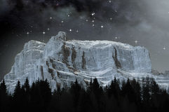 Dolomites in a starry night. View of the Dolomites on a starry night in winter royalty free stock photo