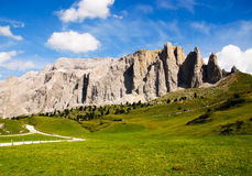 Dolomites in trentino alto adige italy. View of dolomites mountains, one of their valleys and blue sky with clouds background stock photos