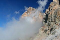 Dolomiti in clouds (Tofana di Rozes) Royalty Free Stock Image