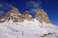 Dolomiti mountains and the slopes of a ski resort in Italian Alps Stock Photos