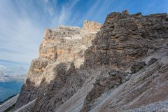 Dolomitic rocky pinnacles in front of Tofana di Rozes southern wall. Cortina d`Ampezzo, Italy stock photography
