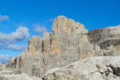 Dolomitis rocky mountain wall. Roky cliff mountains of Dolomites yellow color at sunset. Dolomiti di Brenta, Italy, the Dolomites. Beautiful rocky peak tower stock photos