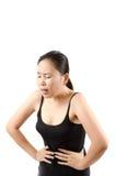 Dolor abdominal de la mujer. Foto de archivo libre de regalías