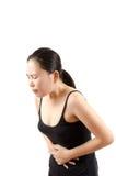 Dolor abdominal de la mujer. Fotografía de archivo