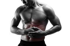 Dolor abdominal del hombre joven, aislado en blanco Foto de archivo libre de regalías