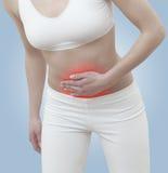 Dolor agudo en un abdomen de la mujer Imagen de archivo libre de regalías