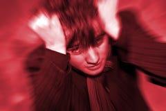 Dolor de cabeza adolescente de la angustia del muchacho Fotografía de archivo libre de regalías