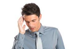 Dolor de cabeza subrayado de With del hombre de negocios foto de archivo libre de regalías