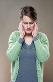 Dolor de cabeza terrible? Imagen de archivo