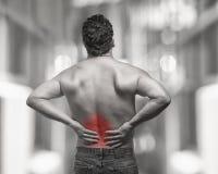 Dolor de espalda Foto de archivo libre de regalías