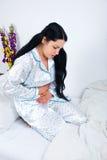 Dolor de estómago de la mujer Foto de archivo