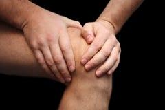 Dolor de la rodilla Foto de archivo libre de regalías