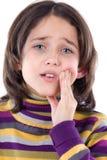 Dolor de muelas adorable de la pizca de la muchacha Fotografía de archivo