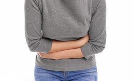 Dolor en el abdomen imagenes de archivo