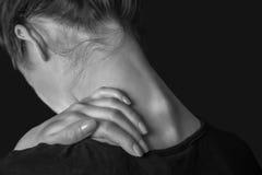 Dolor en el cuello femenino Imágenes de archivo libres de regalías