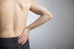 Dolor en el más de espalda en hombres Imagen de archivo libre de regalías