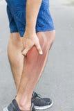 Dolor muscular del becerro Imagenes de archivo