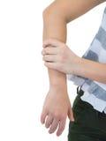 Dolore del braccio della donna su fondo bianco Immagini Stock Libere da Diritti