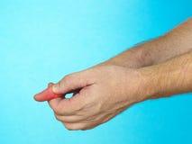 Dolore del dito. Immagine Stock