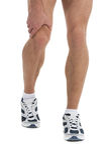 Dolore del ginocchio. Fotografia Stock