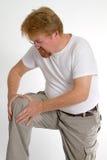 Dolore del ginocchio dell'uomo Fotografia Stock