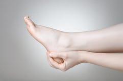 Dolore del piede Fotografie Stock