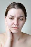 Dolore di orecchio Fotografie Stock