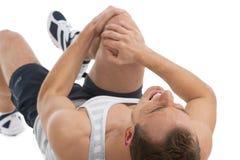 Dolore di sensibilità dell'uomo nel suo ginocchio. Immagini Stock