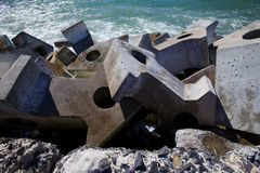 Dolos, concrete block geometric shape at sea stock images