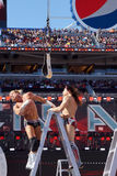 Dolph Ziggler falls off ladder after a headbutt with Daniel Brya Royalty Free Stock Images