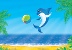 Dolphin. Jumping out from water plays with a multicolor ball Royalty Free Stock Image