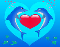Dolphin. Two in love dolphins in the dark blue sea Royalty Free Stock Photos