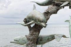 Dolphin copper statue Stock Photo