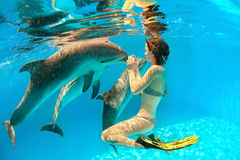 Dolphin and girl royalty free stock photo
