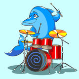 The dolphin is the jazz the drummer. The cheerful, blue dolphin plays on red drums Stock Photo