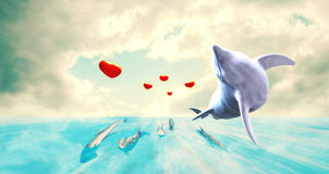 Dolphin Jumps Closeup.Dolphins With Red Balloons with Heart Shape On Their Tails In An Amazing scenery. Dolphins as a symbol of hope, love and peace. They are Royalty Free Stock Photo