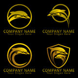 Dolphin Logo Golden Version and Black Background Royalty Free Stock Image
