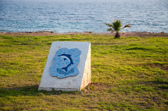 Dolphin mosaic painting. By the seaside Stock Photo