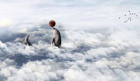 Dolphin playing in the clouds royalty free stock image