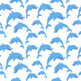 Dolphin seamless 2d pattern on blue background Stock Photos
