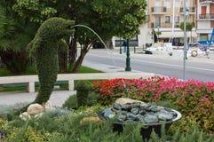 Dolphin Shaped Fountain in City Park Garden Stock Photos